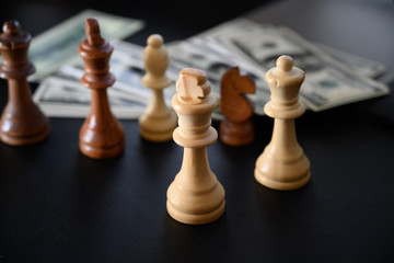 Chess set. Wood chess pieces with money background.