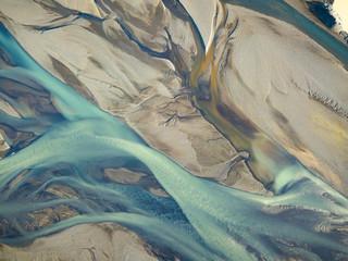 Aerial view of icy river showing veins