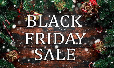 Black Friday Sale on Christmas wooden decoration background