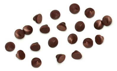 Scattered chocolate chips morsels or drops from top view isolated on white background