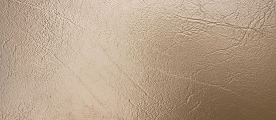 Panorama bronze leather texture background. Pale bronze leather texture