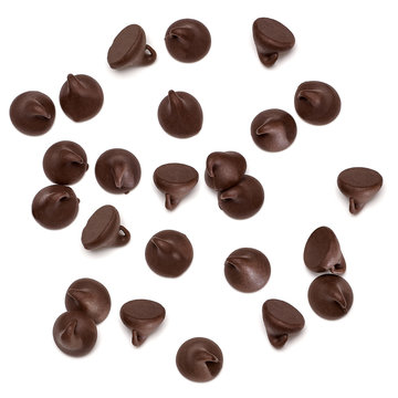 Scattered chocolate chips morsels or drops pile from top view isolated on white background