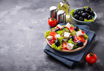 Traditional Greek salad with feta, olives and vegetables Fototapete