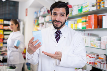 Cheerful specialist who is holding medicines