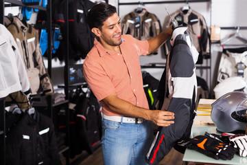 Man choosing jacket for moto