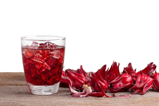 roselle mocktail drink with roselle fruits or Hibiscus sabdariffa on wooden .Jamaica sorrel .