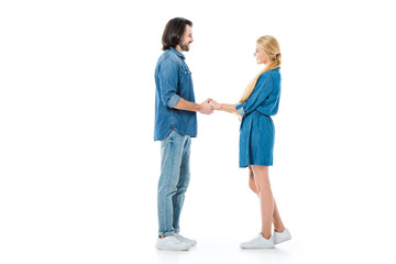 Man and woman holding hands and looking at each other isolated on white