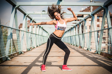 Zumba dance fitness instructor doing sport aerobic exercises. Motivational coach