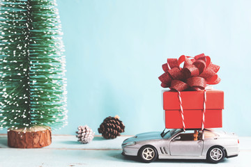 Christmas holiday toys collection with gift box on car. Vintage filter effect
