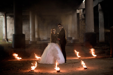 Dressed in wedding clothes romantic zombie couple.