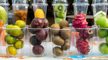 many fresh fruits in the glass for make to smoothie shake