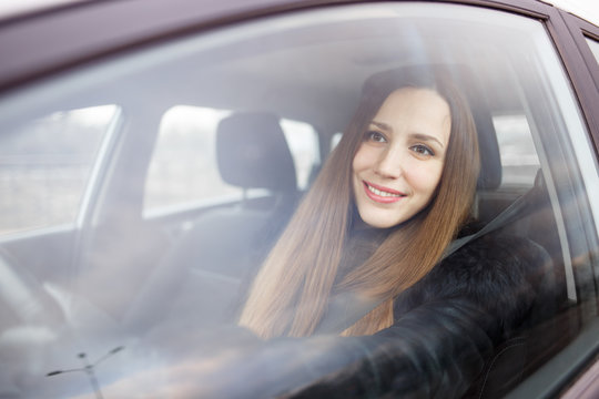 Young lady driving a car in winter