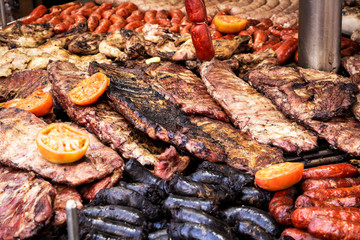 outdoor barbeque with sausages, sausages and peppers pork ribs