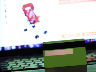 Credit card on laptop, baby products