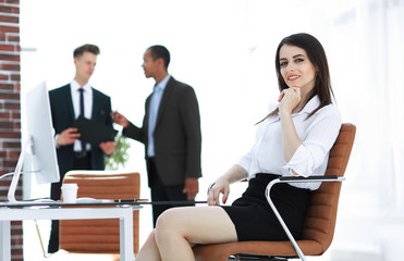 successful business woman sitting at Desk in her office