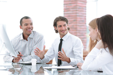 Manager holds a meeting with the business team