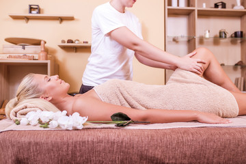 Woman having legs massage
