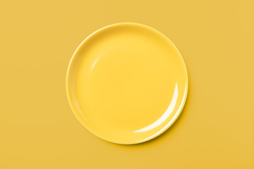 Yellow pastel plate on same colored background