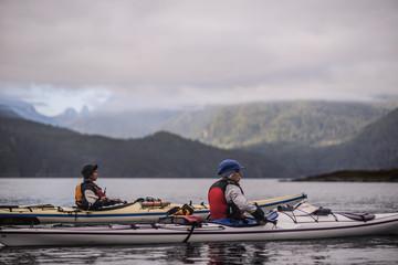 70f54f1603 Friends kayaking in lake