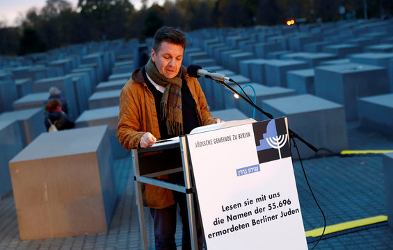A volunteer of the Berlin's Jewish community reads out all names of Jews murdered in the city during the Holocaust in Berlin