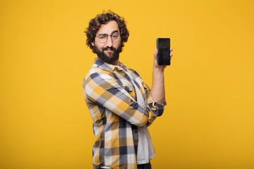 young crazy mad man  fool pose with a smart mobile telephone