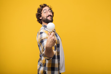 young crazy mad man  fool pose with a light bulb. idea or inspir