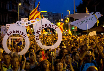 Pro-independence demonstrators gather to mark one year of the Spanish police raid and protest which lead to the imprisonment of the leaders of Catalonia's main pro-independence movements, in Barcelona