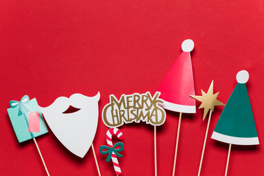Christmas photo booth props on a red background