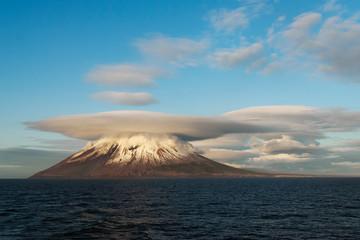 The strange clouds above the Atsonupuri volcano, Iturup island, Kuril islands, Russia. Fototapete