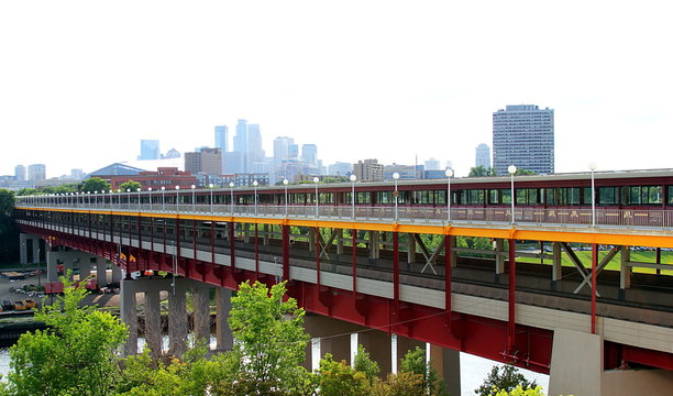 Converging footbridge stretching across University of Minnesota campus.