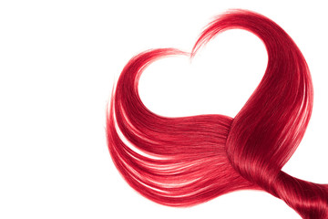 Pink hair in shape of heart, isolated on white background