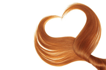 Red hair in shape of heart, isolated on white background