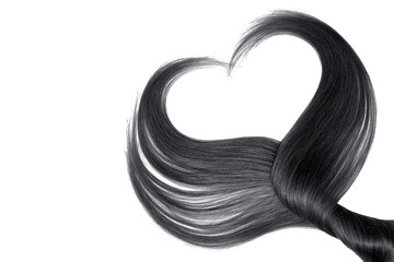 Black hair in shape of heart, isolated on white background