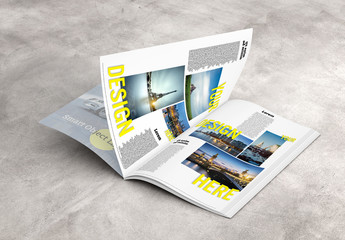 Open Magazine on Concrete Surface Mockup