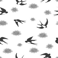Seamless black and white pattern with flying swallows and clouds.