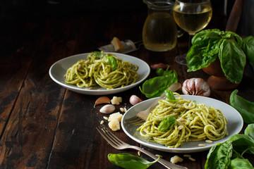 Spaghetti pasta with pesto sauce
