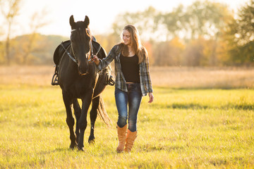 Photo sur cadre textile Equitation Girl horse rider stands near the horse and hugs the horse. Horse theme