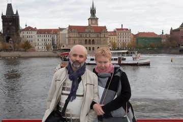 A man and a woman of mature age aboard a riverboat on the Vltava