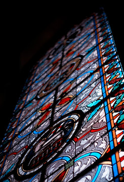 Stained Glass in church. Christianism, religion, holy father and Jesus