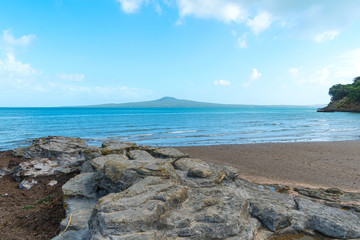 Boulder Rock and Landscape Scenery of St Heliers Beach Auckland New Zealand; View to Rangitoto Island; Calm Sea at Morning Time