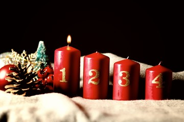 First Sunday (week) of Advent - four Advent candles (with one burning) and Christmas decoration