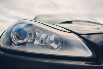 Closeup headlights of modern car. Concept of expensive, sports auto.