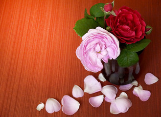 place for text. A bouquet of flowers in a vase. Roses and jasmine.