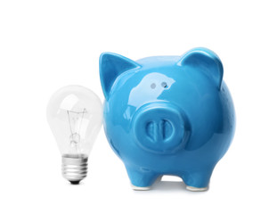 Piggy bank with light bulb on white background