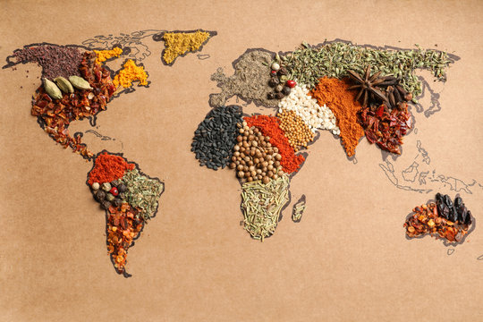 Paper with world map made of different aromatic spices as background, top view