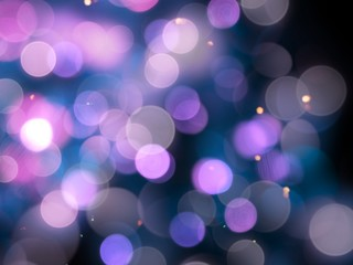 purple blurred round shiny blurred lights abstract with bright sparkles on a black background