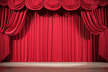 Theater stage with red velvet curtains.