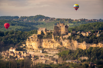 Hot Air Balloons Flying Over Beynac in the Dordogne Valley. France