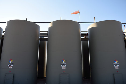 Crude oil production storage holding tanks in the Niobrara Shale of Wyoming, USA.