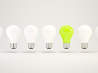 Green light bulb in a row of bulbs